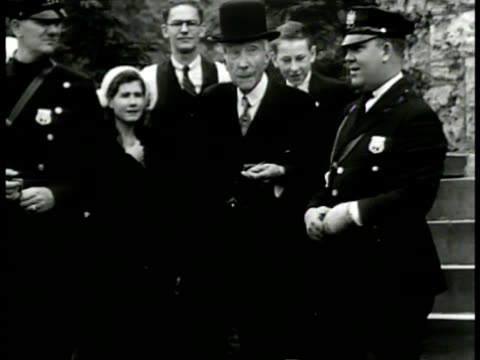 elder john d rockefeller sr walking down steps of church alone standing w/ policemen others at bottom of steps pan ext of florida home john d... - down jacket stock videos and b-roll footage
