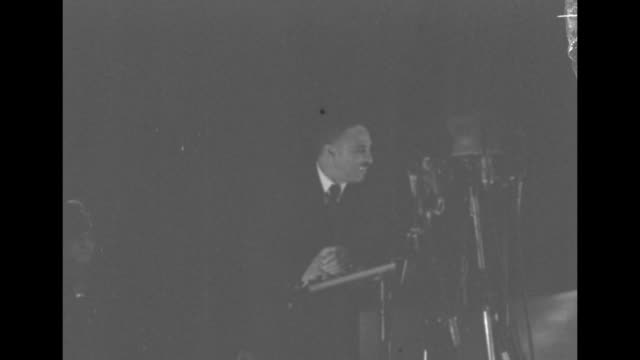 elder lightfoot solomon michaux standing at pulpit preaching during religious service / michaux preaching stops preaching and starts to lead choir in... - 礼拝点の映像素材/bロール