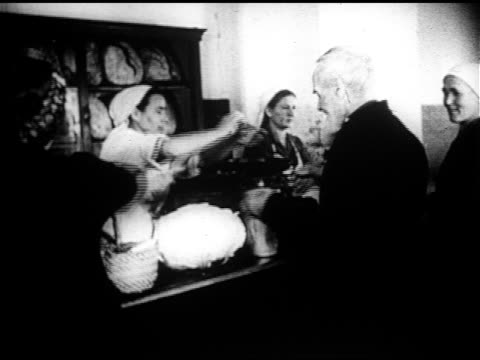 ukraine elder male at counter w/ basket shopkeeper dumping food in ws people at counter w/ covered pails male leaving farming woman gathering grain... - 1946 stock videos and b-roll footage