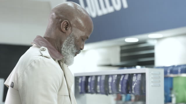 elderly african american man at concession stand, tilt down - unhealthy eating stock videos & royalty-free footage