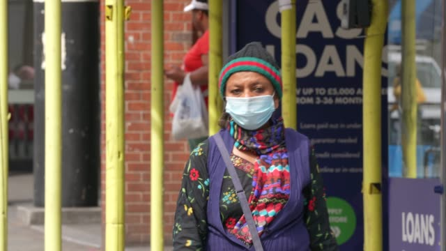 elderly and ethnic minority person wearing ppe face mask in dalston east london during the coronavirus covid19 pandemic the british government... - minoranza video stock e b–roll