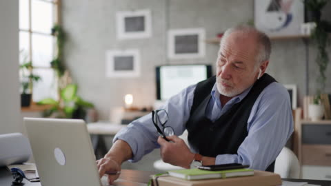 elderly architect using laptop - working at home stock videos & royalty-free footage