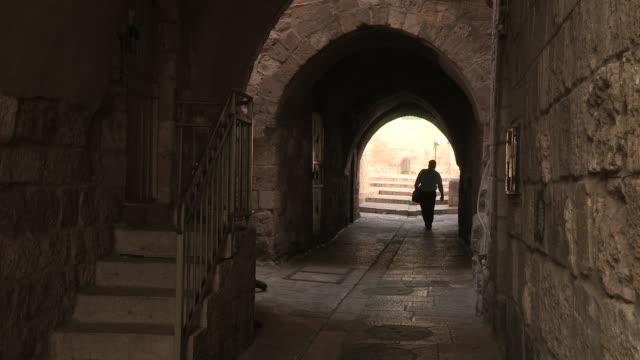 elderly balding man walking through a tunnel towards the camera no - balding stock videos & royalty-free footage