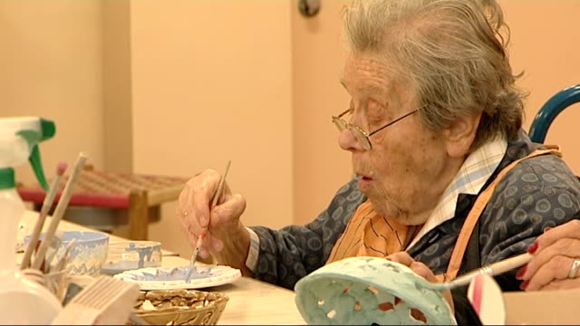 general views of elderly people at care home; england: london: clapham: nightingale care home: int elderly people taking part in art class - cutting... - art class stock videos & royalty-free footage
