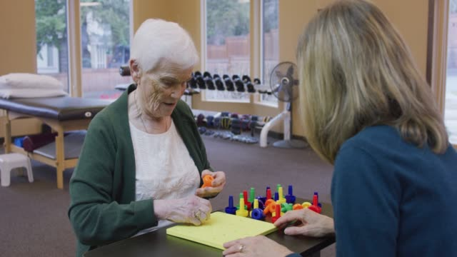 Elderly Caucasian Woman at a Session with a Caucasian Occupational Therapist
