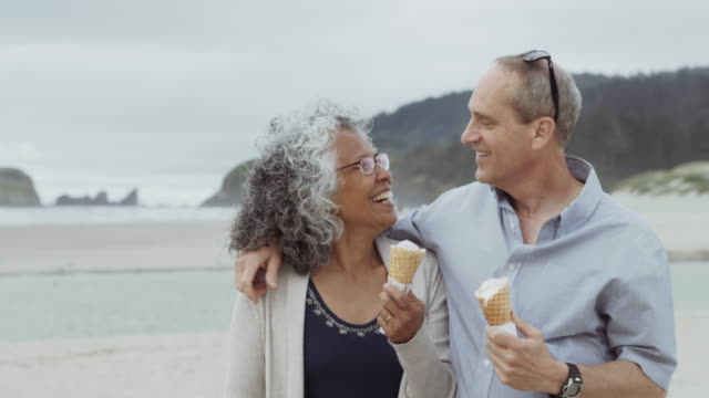 elderly couple eating ice cream at the beach - oregon coast stock videos & royalty-free footage