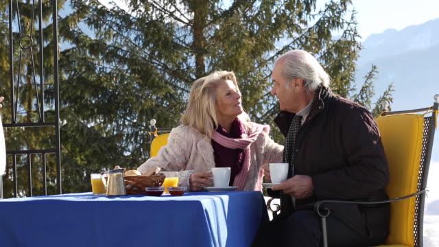 Elderly couple having breakfast in a very nice restaurant
