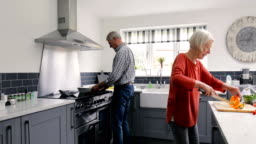 Elderly Couple in the Kitchen Cooking
