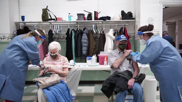 elderly couple receives their moderna vaccine at the hansford senior center in st. albans, west virginia on february 12, 2021. familycare health... - health and safety stock videos & royalty-free footage