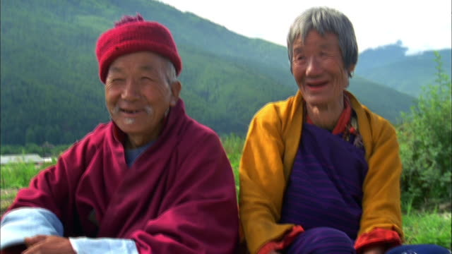 elderly couple sitting in hills available in hd. - bhutan stock videos & royalty-free footage