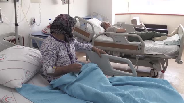 elderly couple who have been rescued by turkish army in a rural area to the northeast of afrin in syria, receive treatment at a state hospital in... - us state border stock videos & royalty-free footage