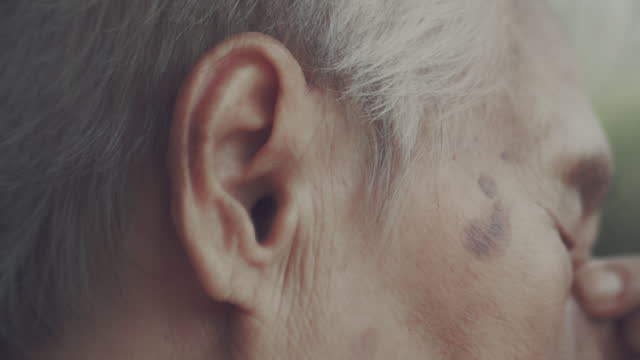elderly emotion - human ear stock videos & royalty-free footage