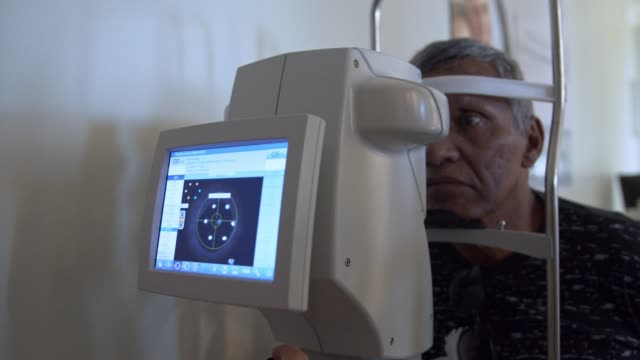 elderly gentleman check his eyesight - optical equipment stock videos & royalty-free footage