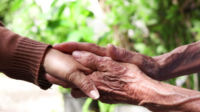 elderly hand and caregiver - visit stock videos & royalty-free footage