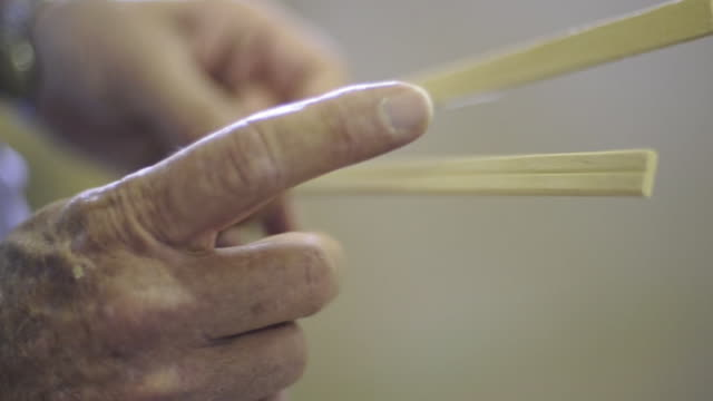 CU Elderly hands holding chopsticks