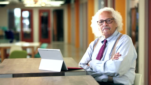 elderly hispanic businessman typing on computer - suspenders stock videos and b-roll footage