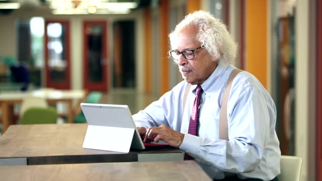 elderly hispanic businessman typing on computer - shirt and tie stock videos & royalty-free footage