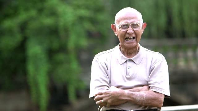 elderly hispanic man standing in the park - over 80 stock videos and b-roll footage