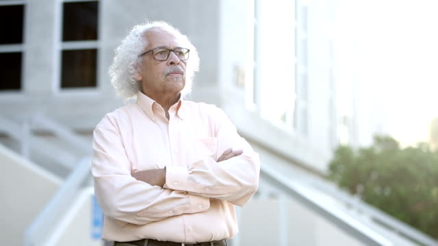 elderly hispanic man standing outside building - white hair stock videos and b-roll footage
