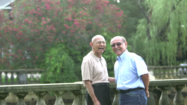 elderly hispanic man talking with his son - only senior men stock videos and b-roll footage