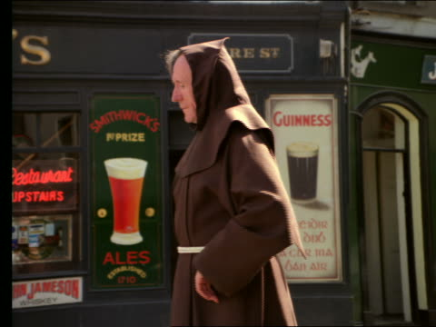 elderly irish monk turning to camera + taking off hood - monk stock videos & royalty-free footage