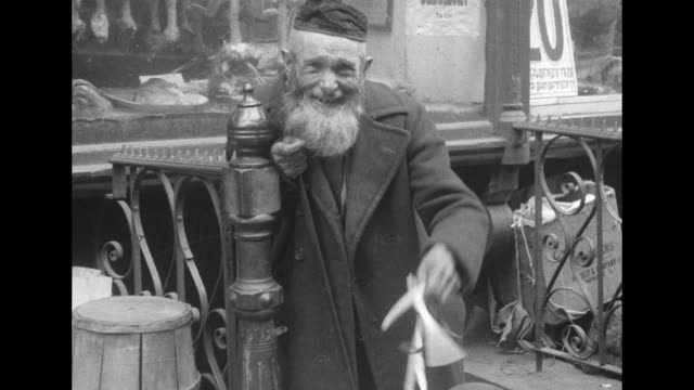 vs elderly jewish men at a street market most wear hats or caps with one man wearing a kippah yarmulke all have beards many smile new york city... - judaism stock videos & royalty-free footage