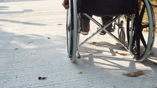 elderly man disabled or handicapped man on wheelchair. - tecnologia assistiva video stock e b–roll