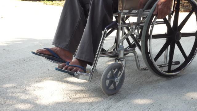 vídeos de stock e filmes b-roll de elderly man disabled or handicapped man on wheelchair. - tecnologia assistiva