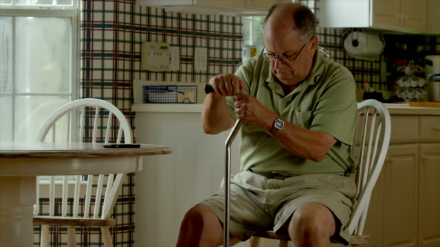 elderly man getting up with injuries - walking stick stock videos & royalty-free footage