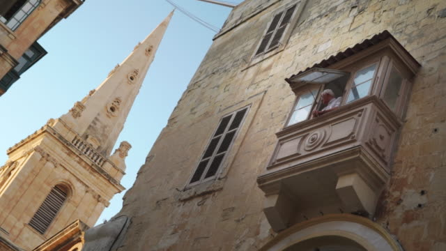 elderly man looking out window - valletta, malta - valletta stock videos & royalty-free footage