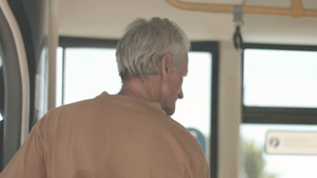 elderly man on bus, close up - buss bildbanksvideor och videomaterial från bakom kulisserna