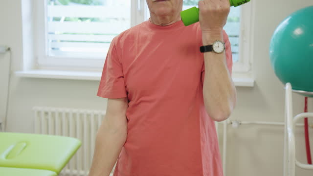 elderly man picking up dumbbells at health club - alternative therapy stock videos & royalty-free footage