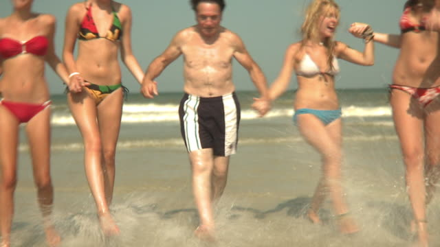 pov shaky ms elderly man running with young women on beach, jacksonville, florida, usa - over 80 stock videos & royalty-free footage