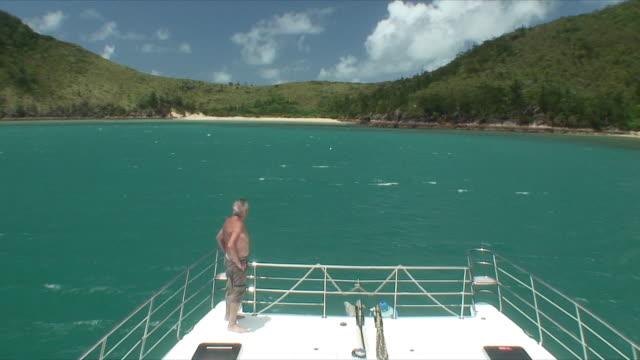 HA WS Elderly man standing on ship's deck, Whitsunday Islands, Queensland, Australia