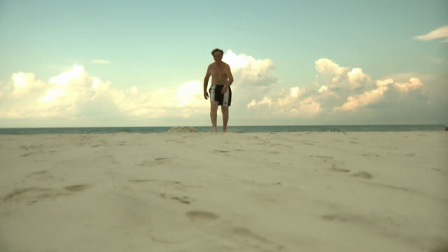 SLO MO WS LA Elderly man walking on beach, Jacksonville, Florida, USA