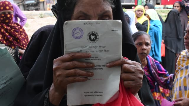 Elderly men and women gather in a crowd waiting to receive their old age allowance at sonali bank near Dhaka The Bangladesh government introduced the...