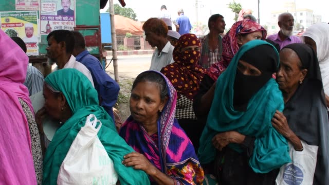 elderly men and women gather in a crowd waiting to receive their old age allowance at sonali bank near dhaka the bangladesh government introduced the... - dhaka stock videos and b-roll footage