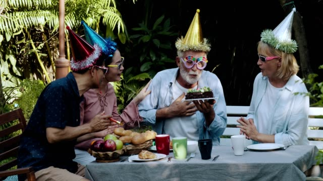 elderly men blowing off birthday candles - birthday stock videos & royalty-free footage