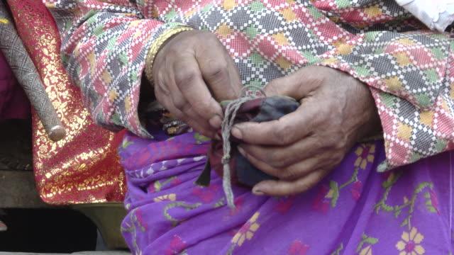 elderly nepali woman in traditional wardrobe offers money to kumari devi - goddess stock videos and b-roll footage