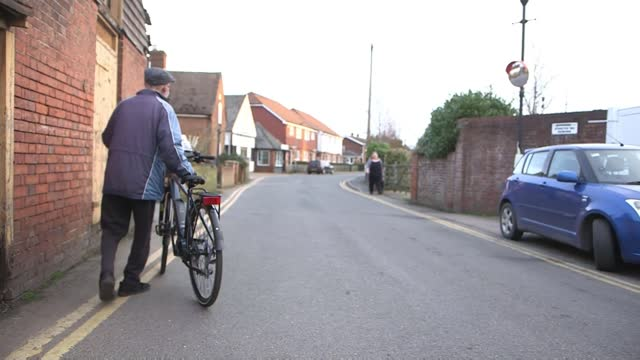 elderly paperboy delays retirement after being given an electric bike; england: kent: headcorn: ext various of george bailey cycling along various of... - news not politics stock videos & royalty-free footage