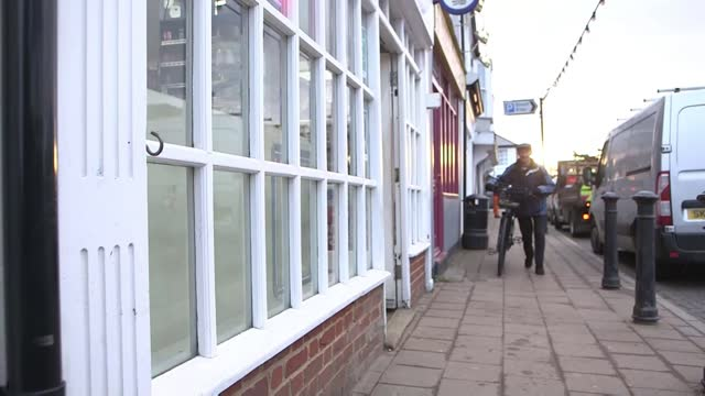elderly paperboy delays retirement after being given an electric bike; england: kent: headcorn: int george bailey into newsagents shop various of... - news not politics stock videos & royalty-free footage