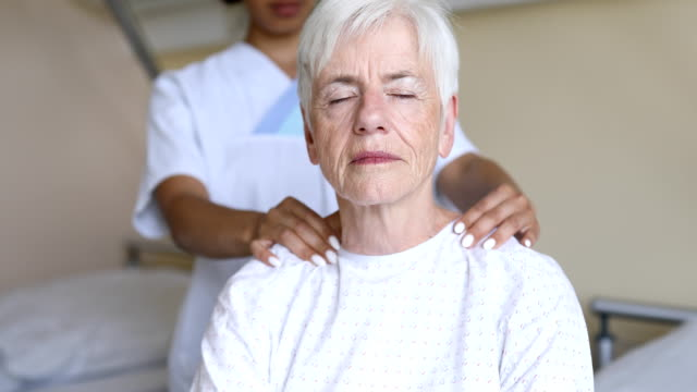 elderly patient getting a massage in rehab - massage stock videos & royalty-free footage