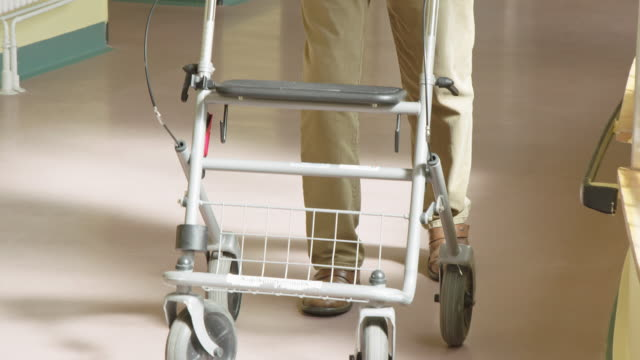 elderly patient using mobility walker in hospital - mobility walker stock videos and b-roll footage