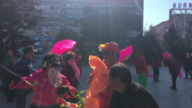 Elderly people dance traditional Yangko on a square
