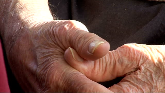 elderly people living in a care home england int close up of older person's hands clasped together / care home resident sitting at table including... - hands clasped stock videos and b-roll footage