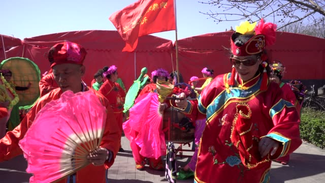 elderly people performance yangko dance on a temple fair to celebrate the birthday of buddha the folk arts of yangge dance are listed as chinese... - buddha's birthday stock videos and b-roll footage