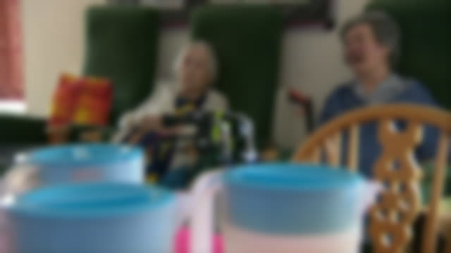 elderly people trying to keep cool in a nursing home during a heatwave - image focus technique stock videos & royalty-free footage