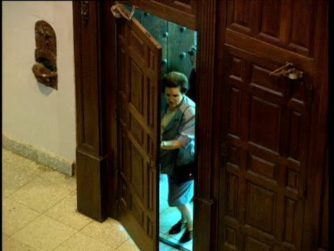 stockvideo's en b-roll-footage met elderly people walk into catholic church and cross themselves basque country spain - gelovige