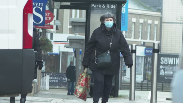 elderly people wear face mask on chelmsford high street december 31, 2020 in chelmsford, england as icu beds are at capacity in many parts of the uk. - protective face mask stock videos & royalty-free footage