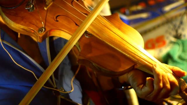 elderly play violin